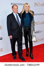 """LOS ANGELES, CA. April 12, 2017: Producer Mike Medavoy & wife Irena Medavoy at the premiere for """"The Promise"""" at the TCL Chinese Theatre, Hollywood."""