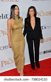 "LOS ANGELES, CA. April 12, 2017: Reality stars Kim Kardashian West & Kourtney Kardashian at the premiere for ""The Promise"" at the TCL Chinese Theatre, Hollywood."