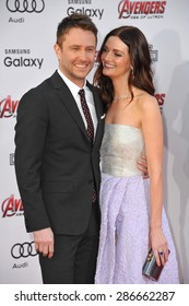 """LOS ANGELES, CA - APRIL 13, 2015: Chris Hardwick & Lydia Hearst at the world premiere of """"Avengers: Age of Ultron"""" at the Dolby Theatre, Hollywood."""