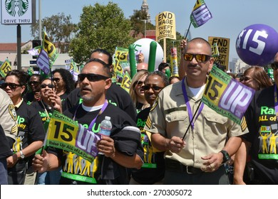 LOS ANGELES, CA   APRIL 15, 2015: Protestors hold signs and flags advocating raising the minimum wage during a demonstration in Los Angeles on April 15, 2015.