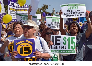 LOS ANGELES, CA   APRIL 15, 2015: Protestors hold signs advocating raising the minimum wage at during a rally in Los Angeles on April 15, 2015.