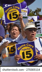 LOS ANGELES, CA  APRIL 15, 2015: Protestors shout and display signs advocating raising the minimum wage for home health care workers during a demonstration in Los Angeles on April 15, 2015.