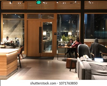 Los Angeles, CA: April 18, 2018: Starbucks Reserve customers inside a Los Angeles Starbucks Reserve store. Starbucks has plans to open several hundred Starbucks Reserve stores in the world.