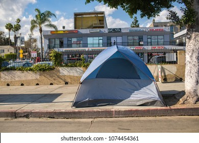 Los Angeles, CA: April 19, 2018: A tent on Hollywood Blvd, where a homeless person resides.  Homelessness has been a growing problem in Los Angeles.