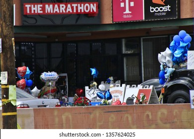 LOS ANGELES CA - APRIL 2, 2019: The storefront of the store owned by Nipsey Hussle where a memorial has been set up to honor him April 2, 2019 Los Angeles CA.