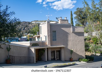 Los Angeles, CA: April 30, 2021:  A residential street near the Hollywood sign. The Hollywood sign is one of the most iconic representations of the Los Angeles area.