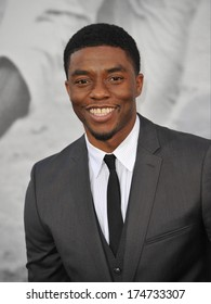 """LOS ANGELES, CA - APRIL 9, 2013: Chadwick Boseman at the Los Angeles premiere of his new movie """"42: The True Story of An American Legend"""" at the Chinese Theatre, Hollywood."""