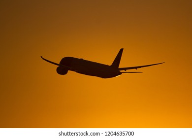 LOS ANGELES, CA - Aug 3, 2018 A Boeing 787 Dreamliner flies into the sunset