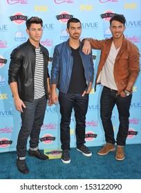 LOS ANGELES, CA - AUGUST 11, 2013: Jonas Brothers - Nick Jonas, Kevin Jonas & Joe Jonas - at the 2013 Teen Choice Awards at the Gibson Amphitheatre, Universal City, Hollywood.