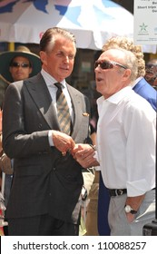 LOS ANGELES, CA - AUGUST 12, 2009: George Hamilton (in suit) & James Caan on Hollywood Blvd where Hamilton was today honored with the 2,388th star on the Hollywood Walk of Fame.