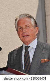 LOS ANGELES, CA - AUGUST 12, 2009: Actor George Hamilton was today honored with the 2,388th star on the Hollywood Walk of Fame.
