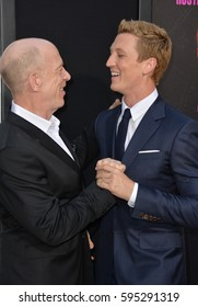 "LOS ANGELES, CA. August 15, 2016: Actors J.K. Simmons & Miles Teller at the Los Angeles premiere of ""War Dogs"" at the TCL Chinese Theatre, Hollywood."