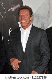 """LOS ANGELES, CA - AUGUST 16, 2012: Arnold Schwarzenegger at the Los Angeles premiere of his movie """"The Expendables 2"""" at Grauman's Chinese Theatre, Hollywood."""