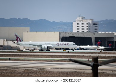 Los Angeles, CA: August 19, 2021:  Qatar Airways airline passenger jet taking off at Los Angeles International Airport (LAX).  Qatar Airways was founded in 1993.