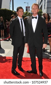 LOS ANGELES, CA - AUGUST 21, 2010: Neil Patrick Harris & David Burtka (left) at the 2010 Creative Arts Emmy Awards at the Nokia Theatre L.A. Live.