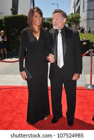 LOS ANGELES, CA - AUGUST 21, 2010: Robin Williams & Susan Schneider at the 2010 Creative Arts Emmy Awards at the Nokia Theatre L.A. Live.