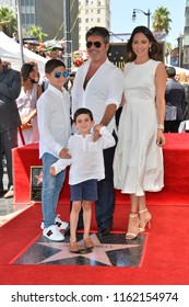 LOS ANGELES, CA. August 22, 2018: Simon Cowell, Lauren Silverman, Eric Cowell & Adam Silverman at the Hollywood Walk of Fame Star Ceremony honoring Simon Cowell.