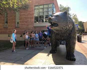 Los Angeles, CA: August 23, 2018:  Bruin Bear on the UCLA campus with prospective students present. UCLA is a public university.