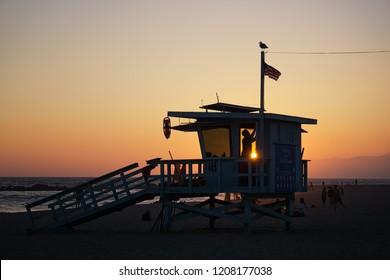 LOS ANGELES, CA - August 25, 2018: Sunset on lifeguard's baywatch on Venice Beach, Los Angeles, California.
