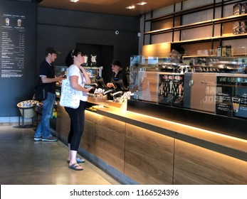 Los Angeles, CA: August 26, 2018:  Starbucks Reserve customers inside a Los Angeles Starbucks Reserve store. Starbucks has plans to open several hundred Starbucks Reserve stores in the world.