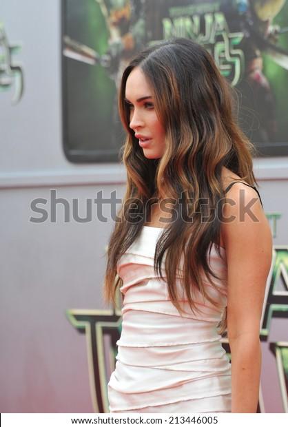 """LOS ANGELES, CA - AUGUST 3, 2014: Megan Fox at the premiere of her movie """"Teenage Mutant Ninja Turtles"""" at the Regency Village Theatre, Westwood."""