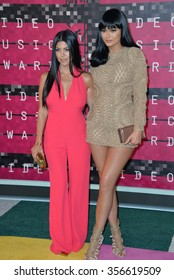 LOS ANGELES, CA - AUGUST 30, 2015: Kourtney Kardashian & Kylie Jenner at the 2015 MTV Video Music Awards at the Microsoft Theatre LA Live.