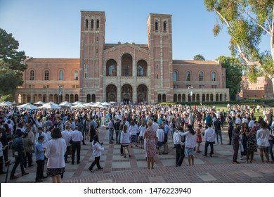 Los Angeles, CA:  August 9, 2019:  UCLA School of Medicine graduates with their families at a celebratory event.  UCLA is a public university in the city of Los Angeles.