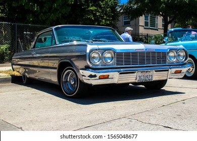 Los Angeles, CA - CIRCA 2019: Front view of a vintage restored Chevy Chevrolet Impala classic American Lowrider Car with Chrome Wire Rims