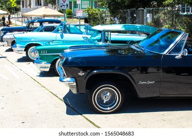 Los Angeles, CA - CIRCA 2019: Side view of a vintage restored Chevy Chevrolet Impala classic American Lowrider and Hot Rod Cars with Custom Chrome and Rims