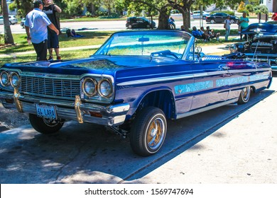 Los Angeles, CA - CIRCA 2019: Vintage restored Chevy Chevrolet Impala classic American Lowrider Car with Custom Paint, Wire Rims and Hydraulics