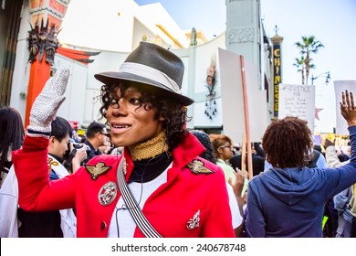 LOS ANGELES, CA - DEC 13, 2014: Michael Jackson Impersonator with white glove in hands up position in Justice for Blacks Demonstration in Hollywood, Los Angeles, California, Dec 13, 2014.