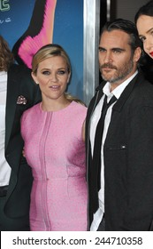 """LOS ANGELES, CA - DECEMBER 10, 2014: Reese Witherspoon & Joaquin Phoenix at the Los Angeles premiere of their movie """"Inherent Vice"""" at the TCL Chinese Theatre, Hollywood."""