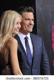 "LOS ANGELES, CA - DECEMBER 10, 2014: Josh Brolin & girlfriend Kathryn Boyd at the Los Angeles premiere of his movie ""Inherent Vice"" at the TCL Chinese Theatre, Hollywood."
