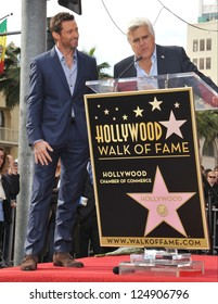 LOS ANGELES, CA - DECEMBER 13, 2012: Hugh Jackman & Jay Leno (right) on Hollywood Blvd where Jackman was honored with the 2,487th star on the Hollywood Walk of Fame.