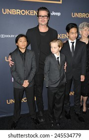 """LOS ANGELES, CA - DECEMBER 15, 2014: Brad Pitt & children Pax Jolie-Pitt, Shiloh Jolie-Pitt & Maddox Jolie-Pitt at the Los Angeles premiere of """"Unbroken"""" at the Dolby Theatre, Hollywood."""