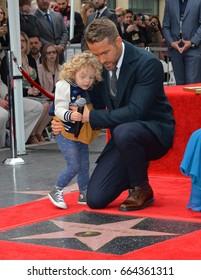 LOS ANGELES, CA - DECEMBER 15, 2016: Actor Ryan Reynolds & daughter James Reynolds (2) at the Hollywood Walk of Fame Star Ceremony honoring actor Ryan Reynolds.Los Angeles, CA.