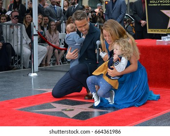 LOS ANGELES, CA - DECEMBER 15, 2016: Actor Ryan Reynolds & wife actress Blake Lively & daughters James Reynolds (2) & baby at the Hollywood Walk of Fame Star Ceremony honoring Ryan Reynolds.
