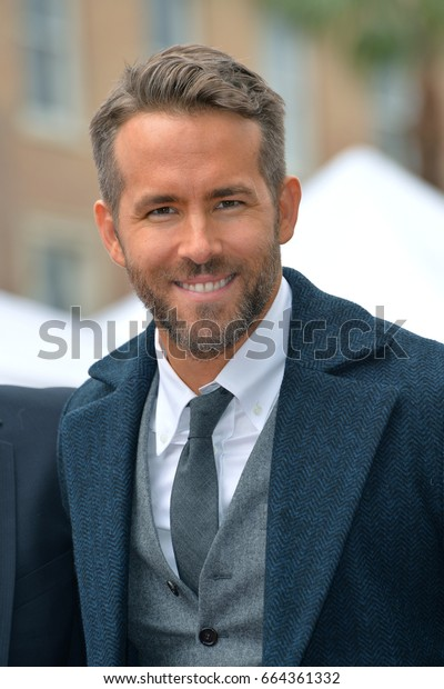 LOS ANGELES, CA - DECEMBER 15, 2016: Actor Ryan Reynolds at the Hollywood Walk of Fame Star Ceremony honoring actor Ryan Reynolds.Los Angeles, CA.