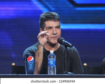 "LOS ANGELES, CA - DECEMBER 17, 2012: Simon Cowell at the press conference for the season finale of Fox's ""The X Factor"" at CBS Televison City, Los Angeles."