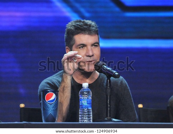 """LOS ANGELES, CA - DECEMBER 17, 2012: Simon Cowell at the press conference for the season finale of Fox's """"The X Factor"""" at CBS Televison City, Los Angeles."""