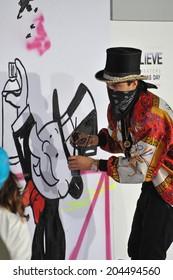 "LOS ANGELES, CA - DECEMBER 18, 2013: Graffiti artist Alec Monopoly at the world premiere of ""Justin Bieber's Believe"" at the Regal Cinemas LA Live."