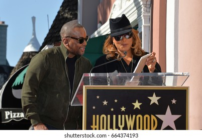 LOS ANGELES, CA. December 2, 2016: Lee Daniels & Queen Latifah at star ceremony for director Lee Daniels on the Hollywood Walk of Fame.