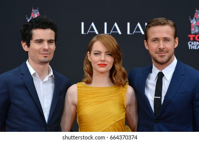LOS ANGELES, CA - DECEMBER 7, 2016: Actors Emma Stone & Ryan Gosling with director Damien Chazelle at the TCL Chinese Theatre, where the stars of La La Land had their hand & footprints set in cement