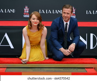 LOS ANGELES, CA - DECEMBER 7, 2016: Actors Emma Stone & Ryan Gosling at the TCL Chinese Theatre, Hollywood, where the stars of La La Land had their hand & footprints set in cement.