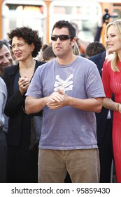LOS ANGELES, CA - FEB 22: Adam Sandler at a ceremony where Jennifer Aniston is honored with a star on the Hollywood Walk of Fame on February 22, 2012 in Los Angeles, California