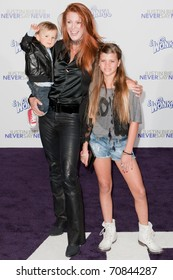 LOS ANGELES, CA - FEB 8: Angie Everhart and family arrive at the Justin Bieber: Never Say Never premiere at Nokia Theater L.A. Live on February 8, 2011 in Los Angeles, California.