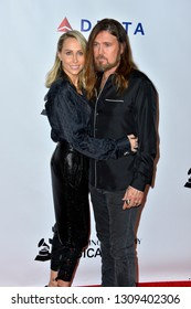 LOS ANGELES, CA. February 08, 2019: Billy Ray Cyrus & Letitia Cyrus at the 2019 MusiCares Person of the Year Gala  at the Los Angeles Convention Centre. Picture: Paul Smith/Featureflash