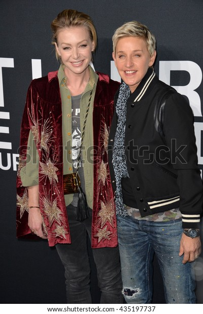 LOS ANGELES, CA - FEBRUARY 10, 2016: Portia de Rossi & Ellen Degeneres arriving at the Saint Laurent at the Palladium fashion show at the Hollywood Palladium.