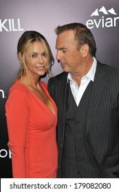 """LOS ANGELES, CA - FEBRUARY 12, 2014: Kevin Costner & wife Christine Baumgartner at the US premiere of his movie """"3 Days To Kill"""" at the Arclight Theatre, Hollywood."""