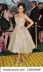"""LOS ANGELES, CA - FEBRUARY 13, 2013: Mila Kunis at the world premiere of her movie """"Oz: The Great and Powerful"""" at the El Capitan Theatre, Hollywood."""
